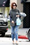th_11225_Celebutopia-Kate_Walsh_with_ripped_jeans_in_Hollywood-10_122_484lo.JPG