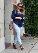 http://img244.imagevenue.com/loc535/th_130035657_Hilary_Duff_at_hair_salon_in_Beverly_Hills20_122_535lo.jpg